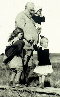 Black and White Photo of Alexander Graham Bell and his Grand Children