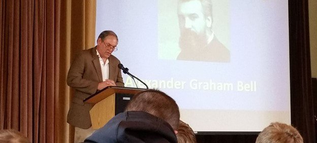 Edwin Grosvenor giving a lecture on Alexander Graham Bell.