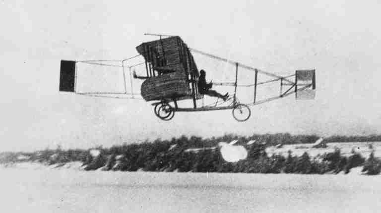 The Silver Dart Plane in flight