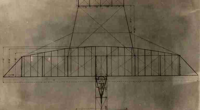 Black and White Photo of an Early Invention of the Plane