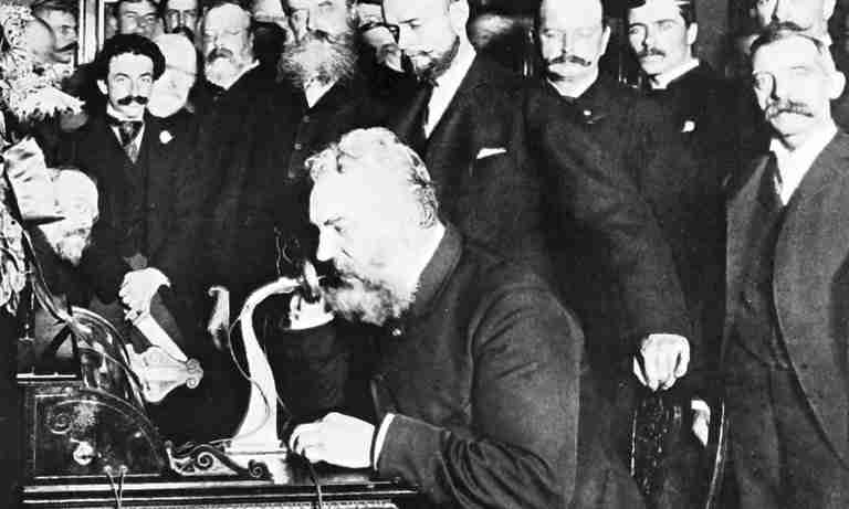 Historic Photo of Alexander Graham Bell demonstrating his invention, the Telephone.